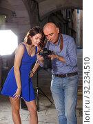 Купить «enthusiastic photographer and model discussing picture on camera display on city street», фото № 32234510, снято 5 октября 2018 г. (c) Яков Филимонов / Фотобанк Лори