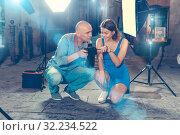 Купить «Photographer showing photos on camera to model girl», фото № 32234522, снято 5 октября 2018 г. (c) Яков Филимонов / Фотобанк Лори