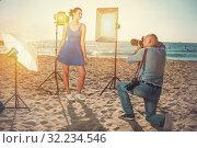 Купить «Woman posing for photographer on seaside», фото № 32234546, снято 5 октября 2018 г. (c) Яков Филимонов / Фотобанк Лори