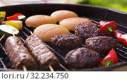 Купить «barbecue kebab meat and vegetables on grill», видеоролик № 32234750, снято 20 сентября 2019 г. (c) Syda Productions / Фотобанк Лори