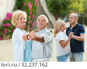 Купить «Adult friends dancing pair dance in garden», фото № 32237162, снято 24 августа 2017 г. (c) Яков Филимонов / Фотобанк Лори