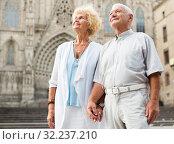 loving mature spouses enjoying walk. Стоковое фото, фотограф Яков Филимонов / Фотобанк Лори