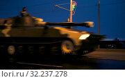 A convoy of military equipment rides through the city at night with headlights on (2019 год). Редакционное видео, видеограф Dzmitry Astapkovich / Фотобанк Лори