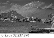 STRESA, ITALY, AUGUST 04, 2019: Lago maggiore lake scenery with mountain water and cloudy sky in summer. Редакционное фото, фотограф Григорий Стоякин / Фотобанк Лори