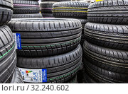 Купить «Summer vehicle tires stacked up for sale in hypermarket», фото № 32240602, снято 25 мая 2019 г. (c) FotograFF / Фотобанк Лори