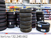 Купить «Vehicle tires stacked up for sale in the store», фото № 32240662, снято 1 мая 2018 г. (c) FotograFF / Фотобанк Лори