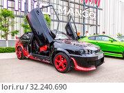 Купить «Tuned Russian automobile Lada at the city street», фото № 32240690, снято 19 мая 2018 г. (c) FotograFF / Фотобанк Лори