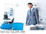 Купить «Businessman with heavy paperwork workload», фото № 32241358, снято 26 июня 2019 г. (c) Elnur / Фотобанк Лори