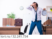 Купить «Young male employee unhappy with excessive work», фото № 32241734, снято 24 мая 2019 г. (c) Elnur / Фотобанк Лори