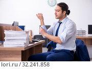 Купить «Young handsome businessman working in the office», фото № 32241858, снято 8 мая 2019 г. (c) Elnur / Фотобанк Лори