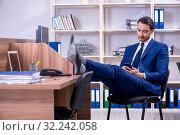 Купить «Young handsome businessman working in the office», фото № 32242058, снято 9 апреля 2019 г. (c) Elnur / Фотобанк Лори
