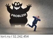 Купить «Businessman afraid of big problem», фото № 32242454, снято 14 октября 2019 г. (c) Elnur / Фотобанк Лори