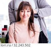 Купить «The man stylist working with woman in beauty salon», фото № 32243502, снято 18 декабря 2017 г. (c) Elnur / Фотобанк Лори
