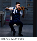 Купить «Young musician man practicing playing violin at home», фото № 32244086, снято 15 августа 2017 г. (c) Elnur / Фотобанк Лори