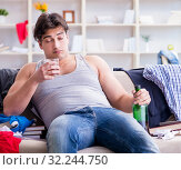 Купить «Young man student drunk drinking alcohol in a messy room», фото № 32244750, снято 4 апреля 2017 г. (c) Elnur / Фотобанк Лори