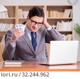 Купить «Businessman gambling playing cards at work», фото № 32244962, снято 18 января 2017 г. (c) Elnur / Фотобанк Лори