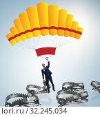 Купить «Businessman falling into trap on parachute», фото № 32245034, снято 19 октября 2019 г. (c) Elnur / Фотобанк Лори