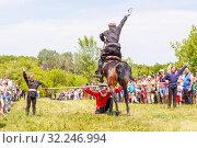 Купить «Russia, Samara, July 2016: Cossack performs tricks on a galloping horse», фото № 32246994, снято 18 июня 2016 г. (c) Акиньшин Владимир / Фотобанк Лори