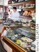 Female seller assisting in choosing dessert. Стоковое фото, фотограф Яков Филимонов / Фотобанк Лори