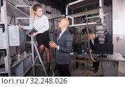 Купить «Businesspeople in escape room stylized under laboratory», фото № 32248026, снято 29 января 2019 г. (c) Яков Филимонов / Фотобанк Лори