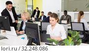Купить «Business people working in coworking space», фото № 32248086, снято 10 марта 2018 г. (c) Яков Филимонов / Фотобанк Лори