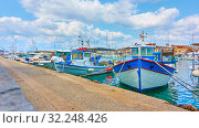 Купить «Port of Aegina and old fishing boats», фото № 32248426, снято 13 сентября 2019 г. (c) Роман Сигаев / Фотобанк Лори