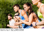 Купить «sportsmen with badge numbers on start of race», фото № 32249658, снято 16 августа 2015 г. (c) Syda Productions / Фотобанк Лори