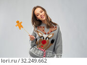 Купить «woman in christmas sweater with reindeer pattern», фото № 32249662, снято 9 декабря 2018 г. (c) Syda Productions / Фотобанк Лори