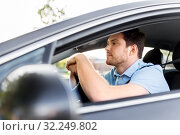 Купить «man or driver driving car in summer», фото № 32249802, снято 25 августа 2019 г. (c) Syda Productions / Фотобанк Лори