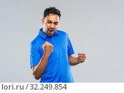 Купить «happy indian man celebrating victory», фото № 32249854, снято 8 сентября 2019 г. (c) Syda Productions / Фотобанк Лори