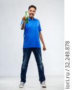 Купить «male fan with beer bottle celebrating victory», фото № 32249878, снято 8 сентября 2019 г. (c) Syda Productions / Фотобанк Лори