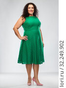 Купить «happy woman in green dress over grey background», фото № 32249902, снято 15 сентября 2019 г. (c) Syda Productions / Фотобанк Лори