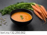 Купить «close up of pumpkin cream soup and vegetables», фото № 32250002, снято 5 апреля 2018 г. (c) Syda Productions / Фотобанк Лори