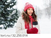 Купить «young woman with hot drink in tumbler in winter», фото № 32250014, снято 29 января 2019 г. (c) Syda Productions / Фотобанк Лори
