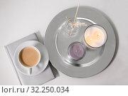 Купить «coffee, candles and aroma reed diffuser on table», фото № 32250034, снято 11 апреля 2019 г. (c) Syda Productions / Фотобанк Лори
