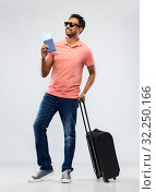 indian man with travel bag passport and air ticket. Стоковое фото, фотограф Syda Productions / Фотобанк Лори