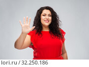 Купить «happy woman in red dress showing five fingers», фото № 32250186, снято 15 сентября 2019 г. (c) Syda Productions / Фотобанк Лори