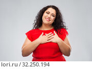 happy woman holding hands on chest or heart. Стоковое фото, фотограф Syda Productions / Фотобанк Лори