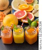 Купить «mason jar glasses of vegetable juices on table», фото № 32250334, снято 5 апреля 2018 г. (c) Syda Productions / Фотобанк Лори