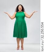 Купить «happy smiling woman in green dress», фото № 32250554, снято 15 сентября 2019 г. (c) Syda Productions / Фотобанк Лори