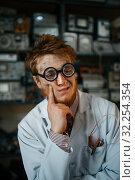 Купить «Portrait of strange male scientist in glasses», фото № 32254354, снято 17 июня 2019 г. (c) Tryapitsyn Sergiy / Фотобанк Лори