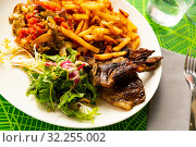 Купить «Grilled of lamb served with french fries and vegetable garnish», фото № 32255002, снято 22 ноября 2019 г. (c) Яков Филимонов / Фотобанк Лори