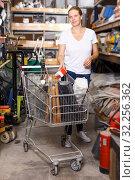 Купить «Woman customer in build store», фото № 32256362, снято 20 сентября 2018 г. (c) Яков Филимонов / Фотобанк Лори