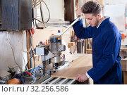 Male worker working with milling cutter at workshop. Стоковое фото, фотограф Яков Филимонов / Фотобанк Лори