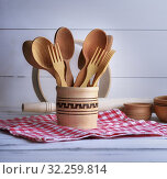 Купить «Wooden spoons and forks in a wooden container on a white table.», фото № 32259814, снято 3 апреля 2018 г. (c) easy Fotostock / Фотобанк Лори