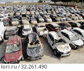 Купить «Aerial view new damaged cars due to flooding in dirt, spoiled can not be restored and used, gota fria September 2019, Orihuela, Torrevieja, Spain», фото № 32261490, снято 21 сентября 2019 г. (c) Alexander Tihonovs / Фотобанк Лори