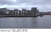 Купить «Современная городская архитектура района Хаммарбю облачным мартовским днем. Стокгольм, Швеция», видеоролик № 32261810, снято 9 марта 2019 г. (c) Виктор Карасев / Фотобанк Лори