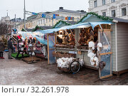 Купить «Small stalls for fur clothing and souvenirs sale are on urban pier. Traditional Christmas market with things, food and other is in center of Helsinki city, Finland», фото № 32261978, снято 29 декабря 2018 г. (c) Кекяляйнен Андрей / Фотобанк Лори