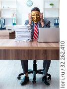 Купить «Businessman wearing mask in hypocrisy concept», фото № 32262410, снято 24 июня 2019 г. (c) Elnur / Фотобанк Лори