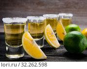 Купить «Tequila drink served in glasses with lime and salt», фото № 32262598, снято 18 сентября 2017 г. (c) Elnur / Фотобанк Лори